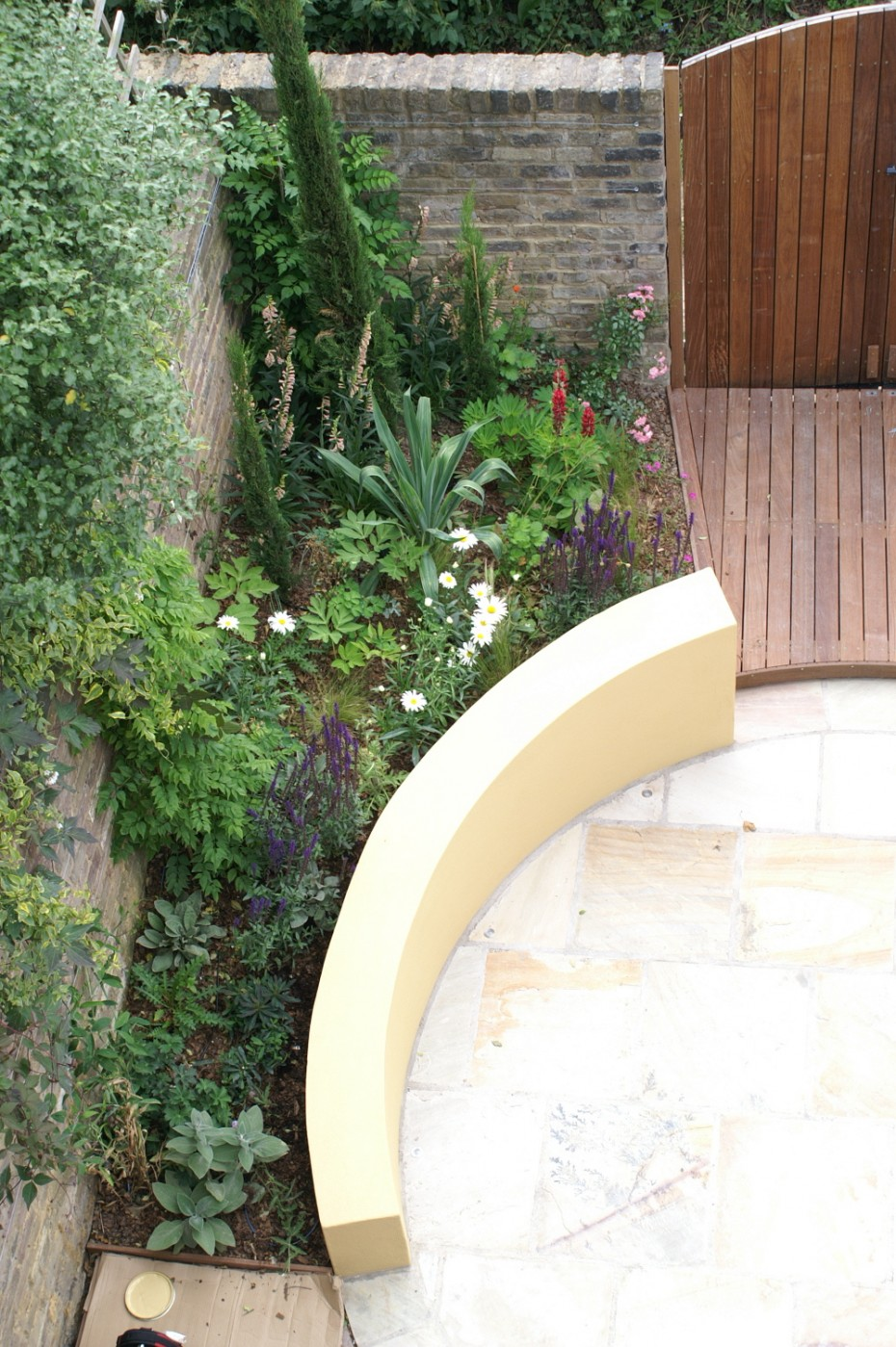 Coutyard garden with decking and double gates